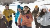 Friends running in winter landscape