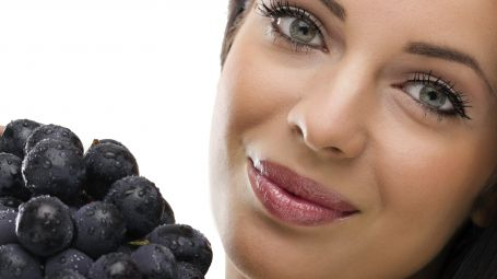 woman and fresh grapes