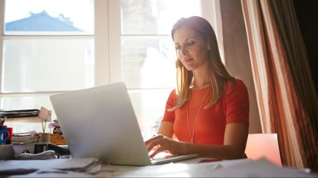 Shot of an attractive businesswoman working on her laptop in her home office